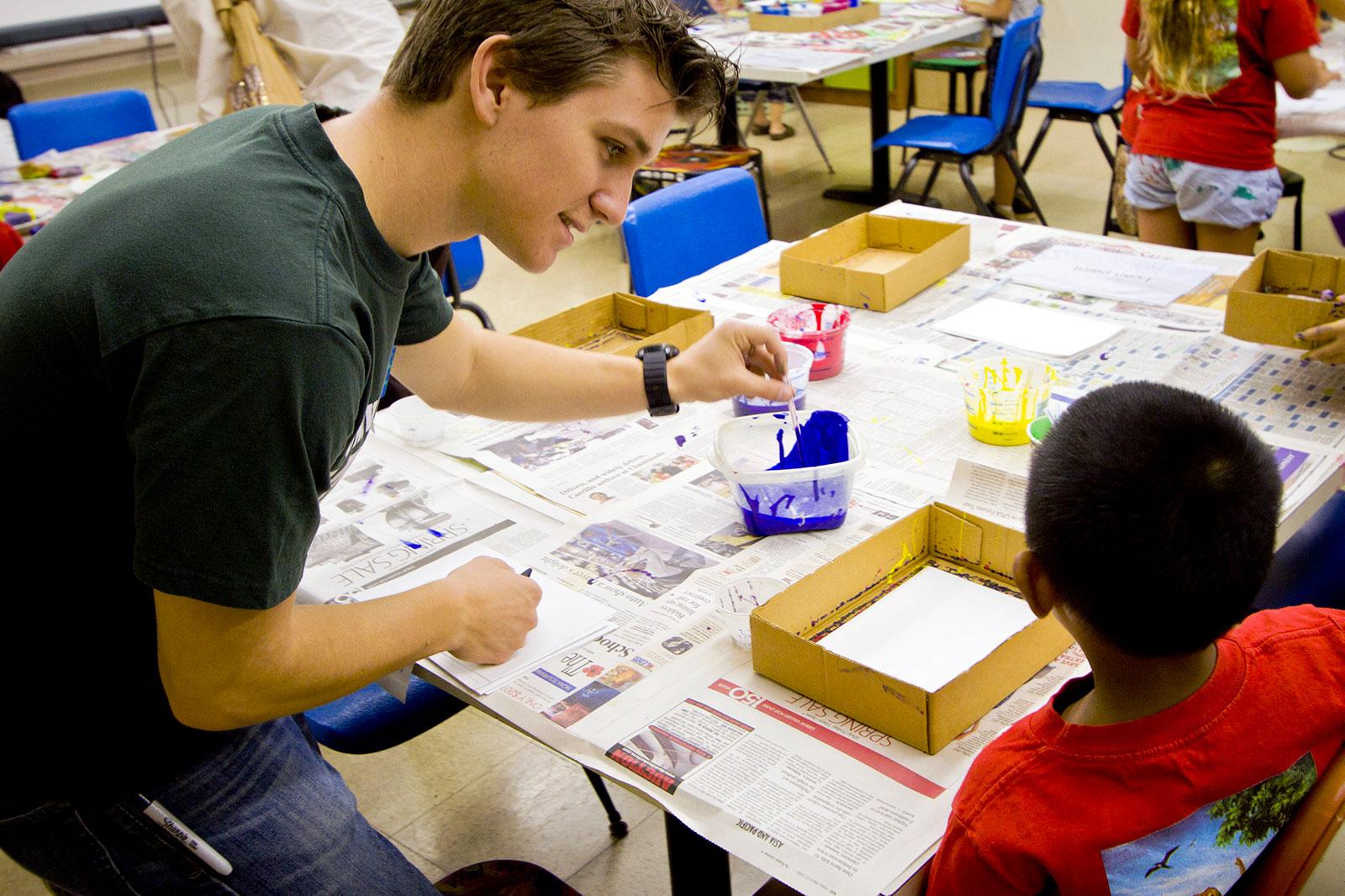 Elementary education student teaching child