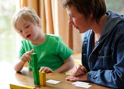 child working with interventionist