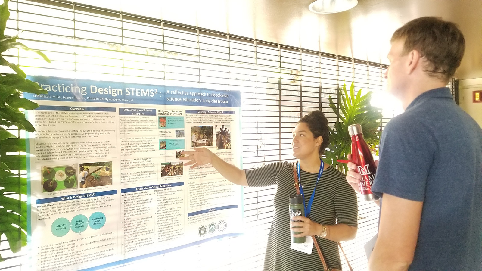 Student presenting poster