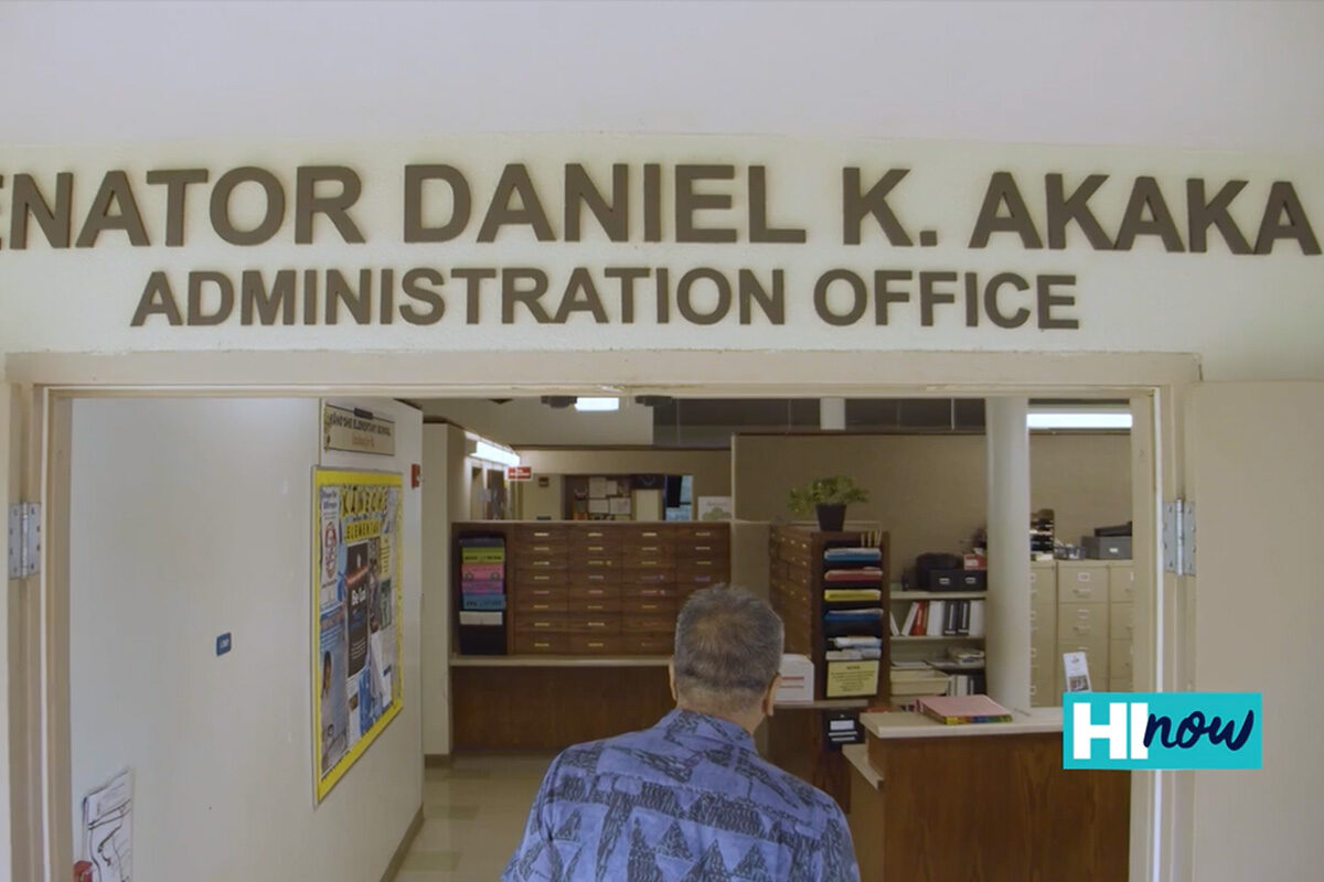 principal walking through doors of admin office