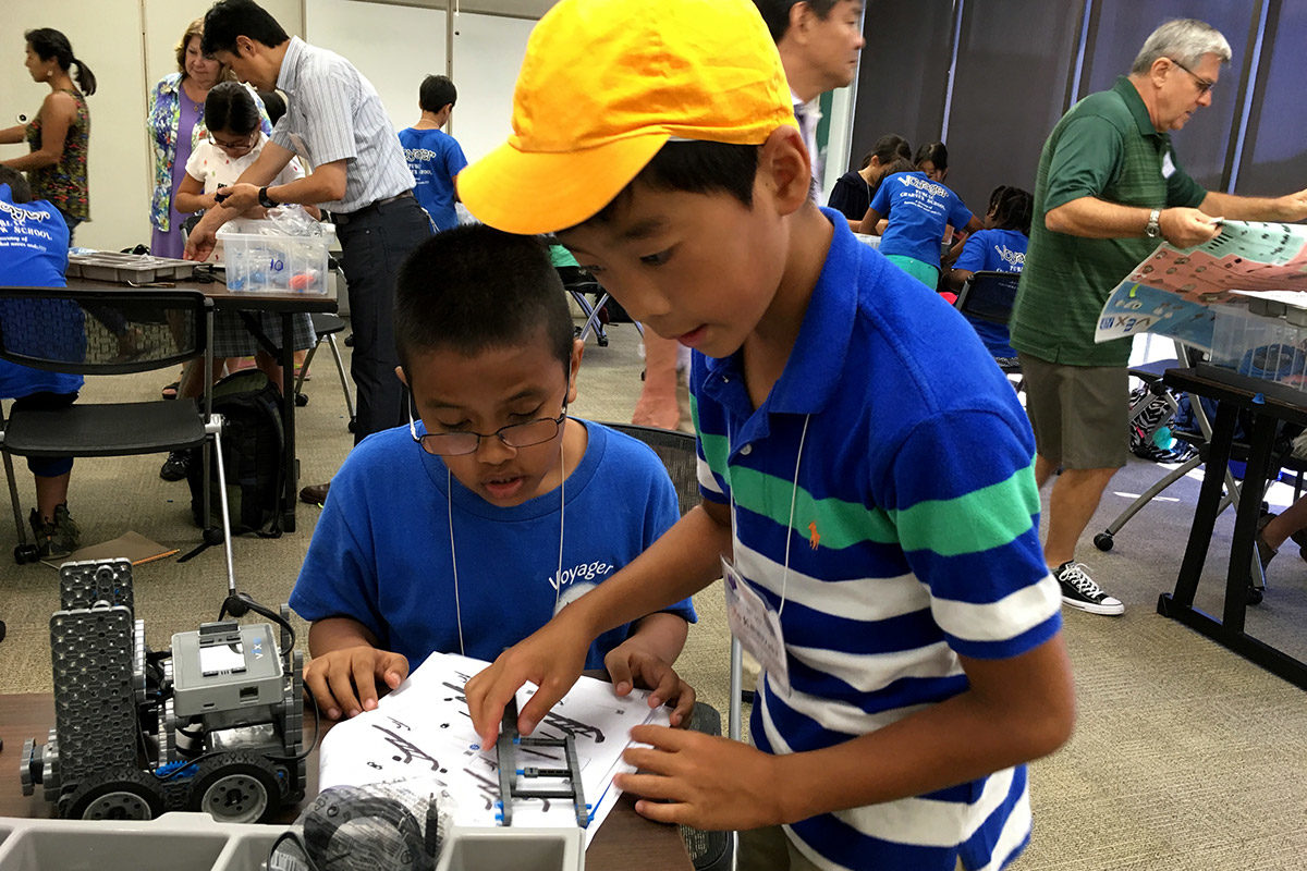 Two students building robots
