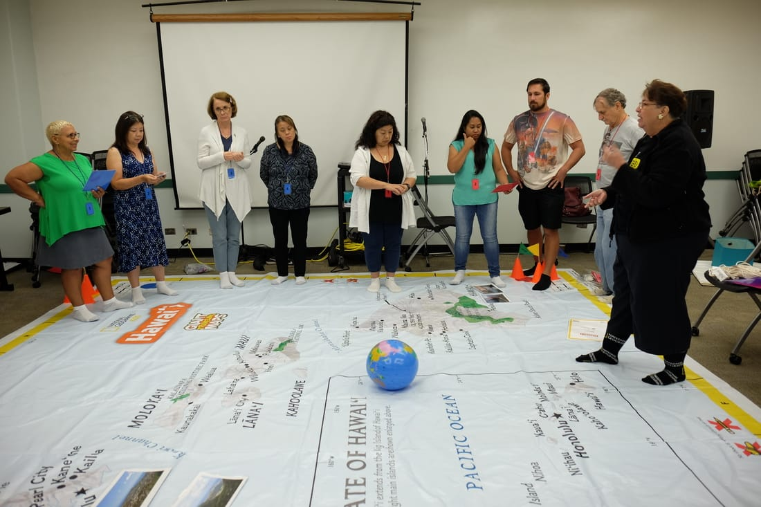 teachers and giant map