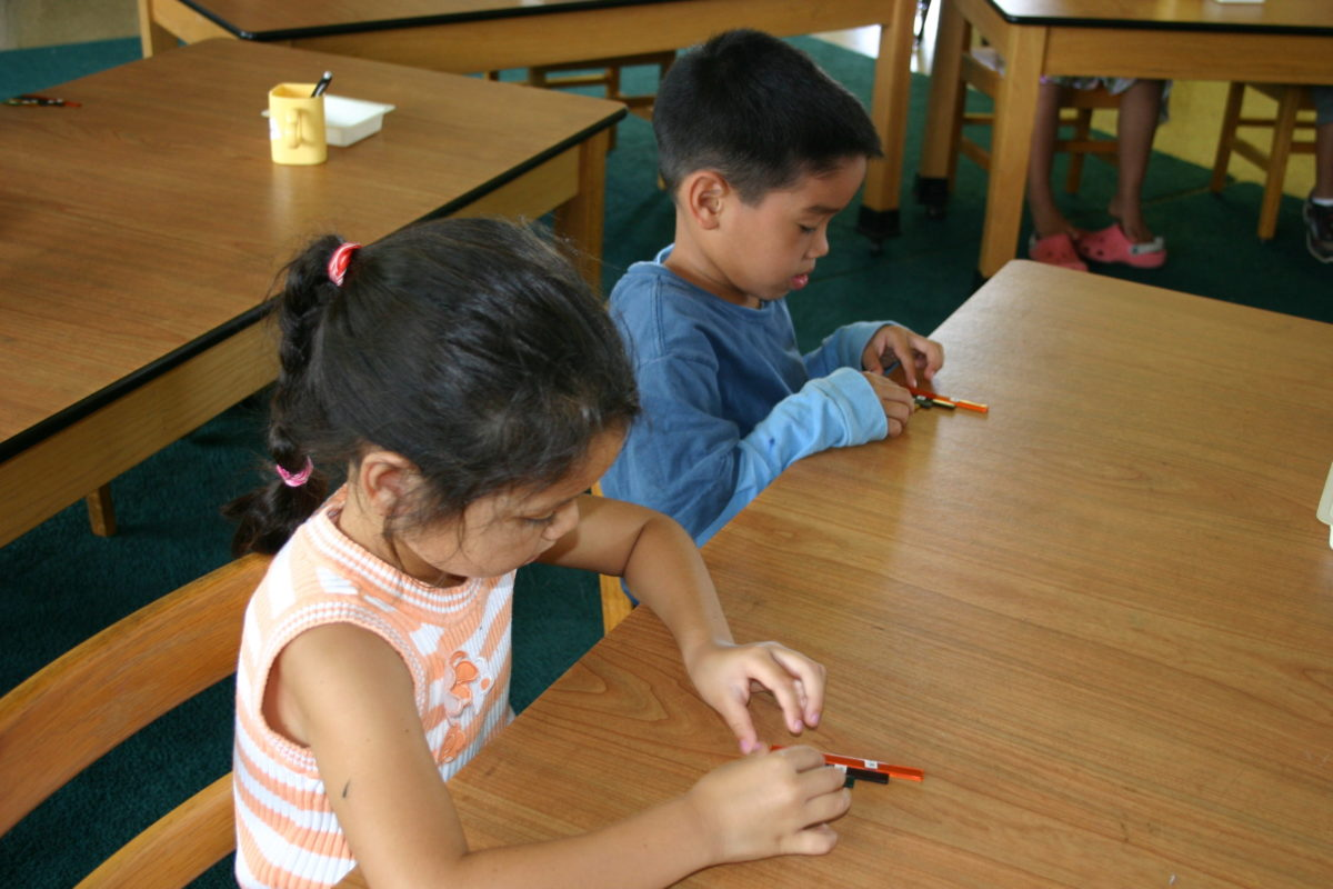 Elementary students working on math